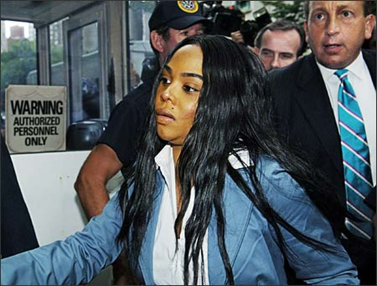 Rap diva Lil' Kim, looking decidedly short on 'tude, enters federal court in New York yesterday for sentencing on a perjury conviction involving a 2001 shootout outside a Manhattan radio station. The Grammy winner, known for raunchy lyrics and flesh-a-delic outfits, got a year and a day in prison and a $50,000 fine. The max was 20 years in prison, The Associated Press says. (LOUIS LANZANO/AP)