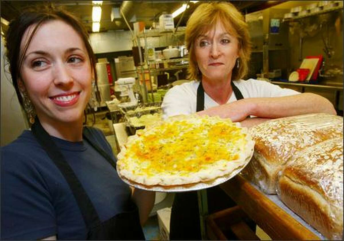 Joan Williams, right, and her daughter, Jill, proudly show off their broccoli and cheddar quiche at 60th Street Desserts.