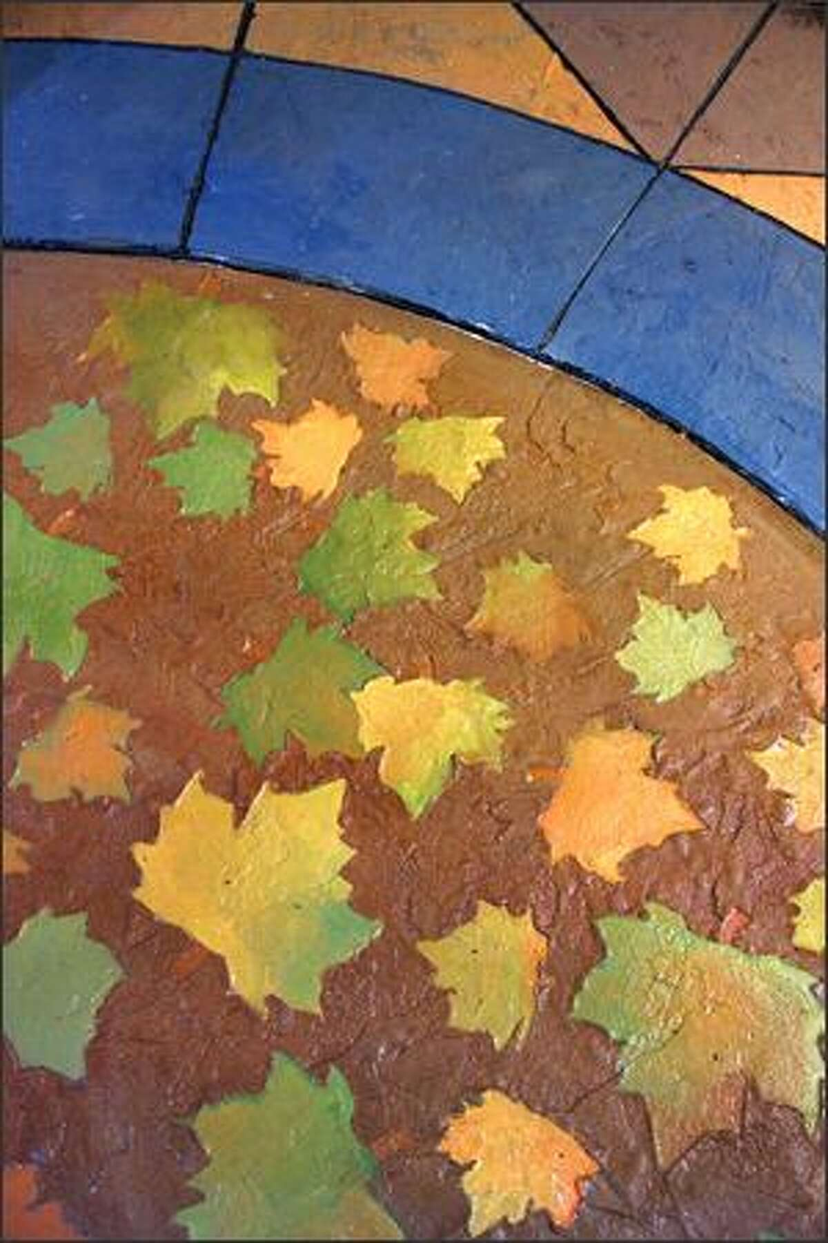 Rick Perry of Falling Water Designs designed this poured, stamped, and colored concrete patio detail.