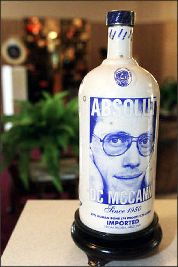 Charles Krafft's artwork includes an urn made from cremated human remains in the shape of a vodka bottle at the request of the deceased's friends. Photo: Loren Callahan, Seattle Post-Intelligencer / Seattle Post-Intelligencer