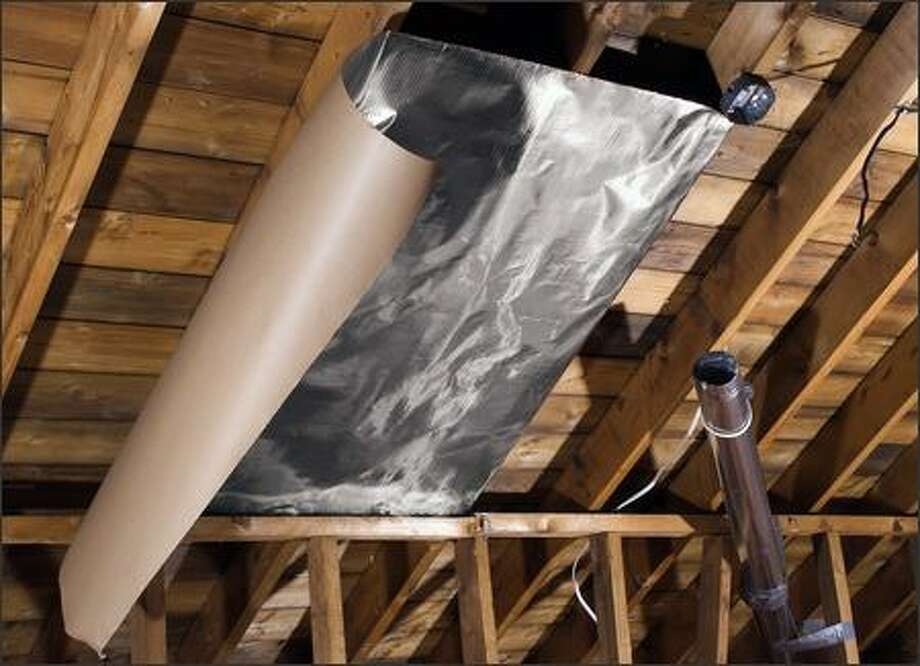 Low-cost single-sided foil is installed with the shiny side down. (TVM BUILDING PRODUCTS)