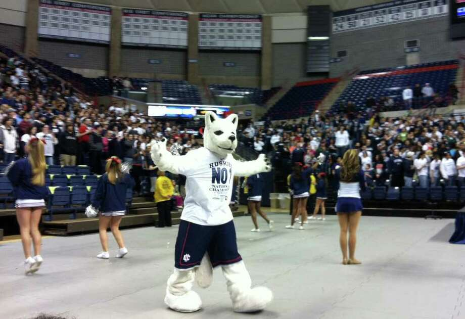 The UConn mascott gets the crowd going as they wait fior the 2011 NCAA championship Huskies to arrive at a rally on campus at Gampel Pavilion on Tuesday April, 5, 2011. Photo: Christian Abraham / Connecticut Post