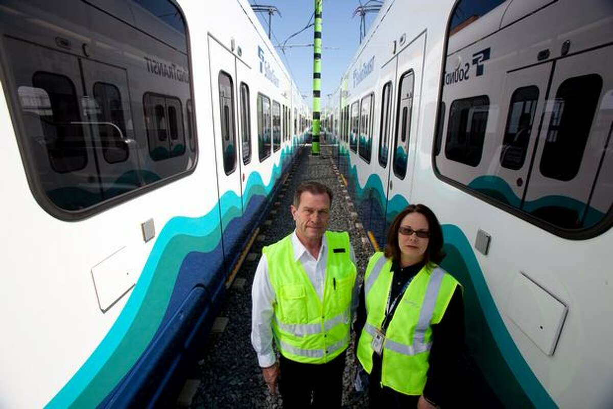 Sound Transit light rail operators John Helm, left, and Annette James are shown in the operations and maintenance center.