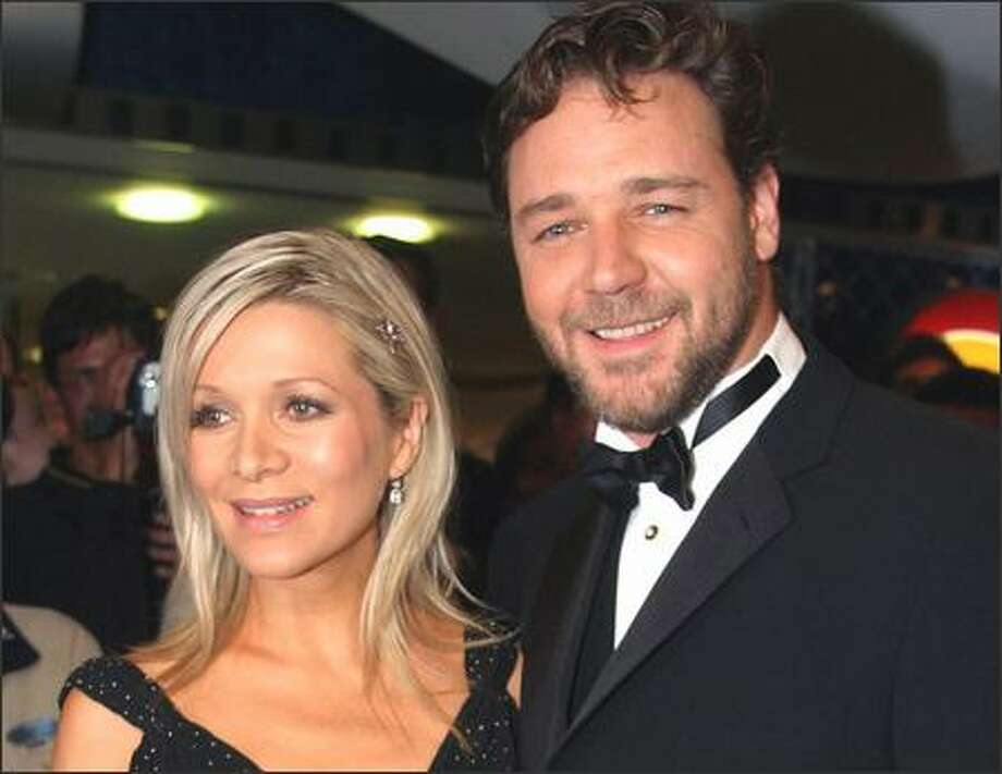 Actor Russell Crowe and his wife, Danielle Spencer, are new parents of a second son, Tenyson Spencer Crowe, born Friday in Sydney, Australia, weighing in at about 8 pounds. First lesson for the Crowe brood? Don't do what Daddy did and throw a phone at a hotel clerk's head. Minus the anger, Crowe's pretty cool. Photo: Associated Press / Associated Press