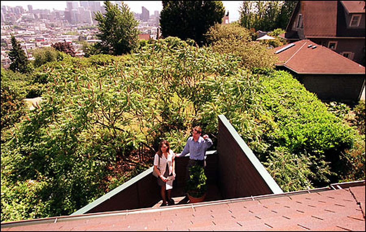 Edward Krigsman, right, a broker for John L. Scott, shows Elaina Valencia a home on Queen Anne Hill. 'It's a good time to be looking,