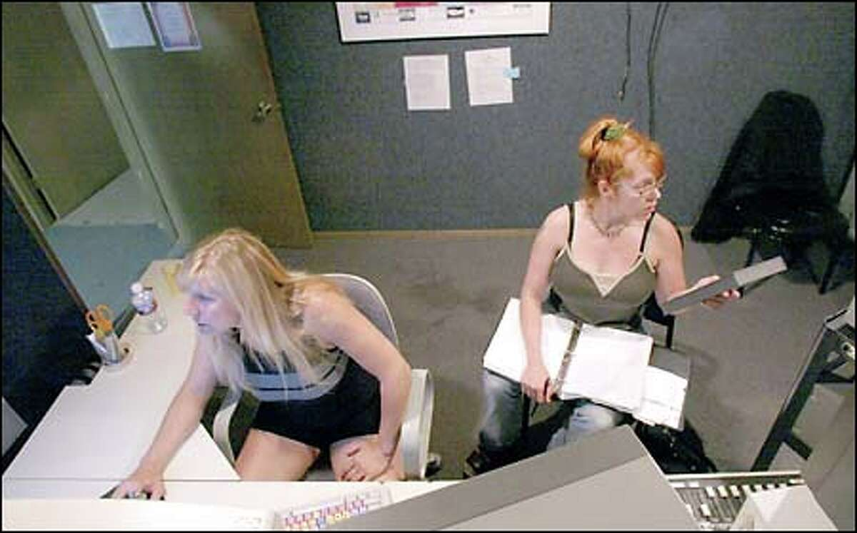 """Sue Corcoran, a film producer and editor, works with writer Angie Rolfs on their film """"Gory Gory Hallelujah"""" in one of the editing rooms at 911 Media Arts Center in Seattle."""