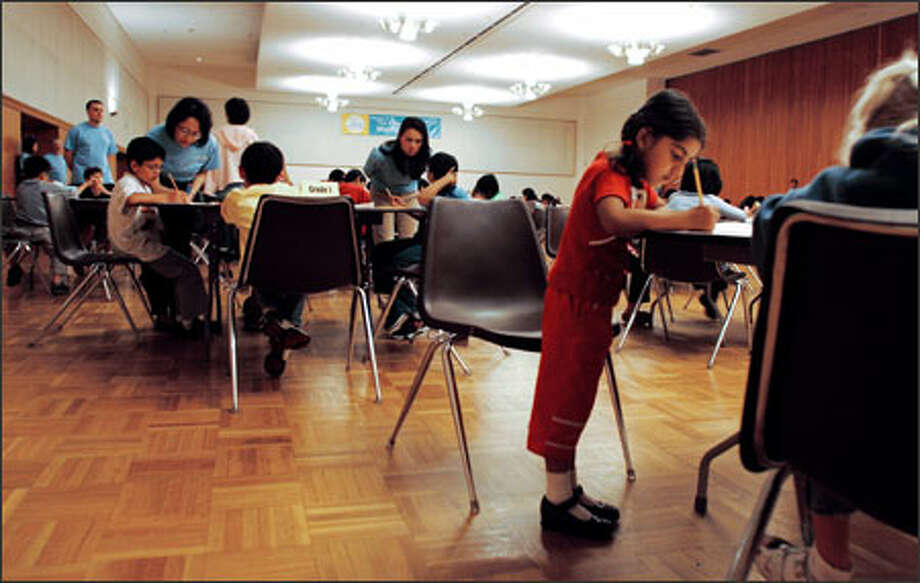 Pragyna Naik, 5, standing, works on her test at the Kumon Math Challenge at the University of Washington yesterday. Children competed for scholarship money in the national event. Photo: Niki Desautels, Seattle Post-Intelligencer / Seattle Post-Intelligencer