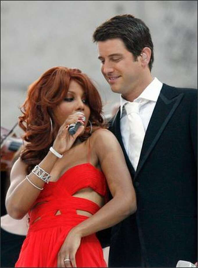 Looks as if Toni Braxton came perilously close to a wardrobe malfunction while singing in Berlin with Sebastian Izambard of the group Il Divo, during the closing ceremonies of soccer's World Cup on Sunday, but Europeans don't tend to get as panicky as Americans when a breast pops out of a garment. Photo: Associated Press / Associated Press