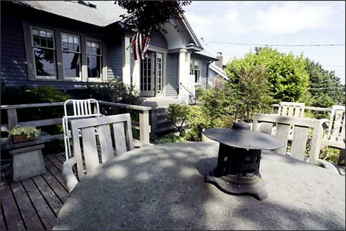 The Boyd's front deck features a stone table where they can just relax and take in the view of lake Washington.
