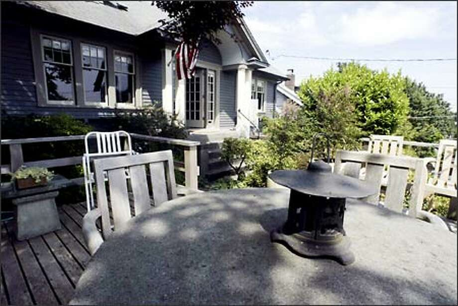 The Boyd's front deck features a stone table where they can just relax and take in the view of lake Washington. Photo: Jim Bryant, Seattle Post-Intelligencer / Seattle Post-Intelligencer