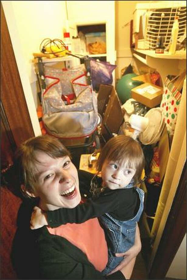 The busier Courtney Hudak's life gets, the more clutter she amasses in her 'scary closet.' Winning the contest is a big relief to this full-time student, part-time worker and all-the-time mother. She's ready to change her ways and spend more time with her daughter, Eva, who is 2. Photo: Scott Eklund, Seattle Post-Intelligencer / Seattle Post-Intelligencer