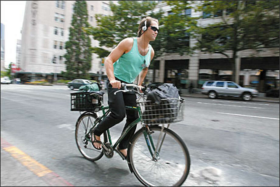 MacLean's transportation is a 10-speed bike, and he pedals to an eclectic mix of music on his iPod. Photo: Scott Eklund, Seattle Post-Intelligencer / Seattle Post-Intelligencer