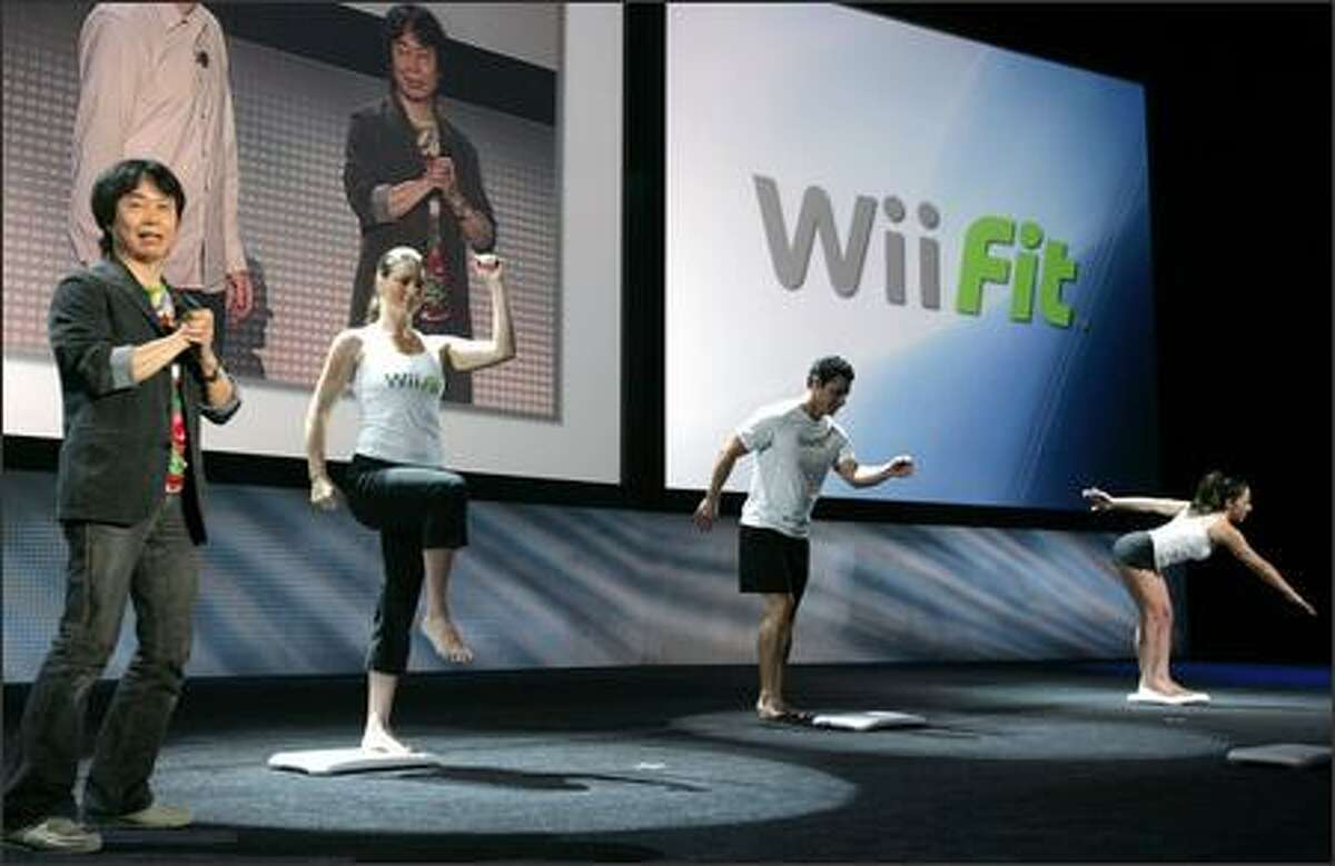 Nintendo game designer Shigeru Miyamoto, left, introduces the new Wii Balance Board during E3 in Santa Monica, Calif.