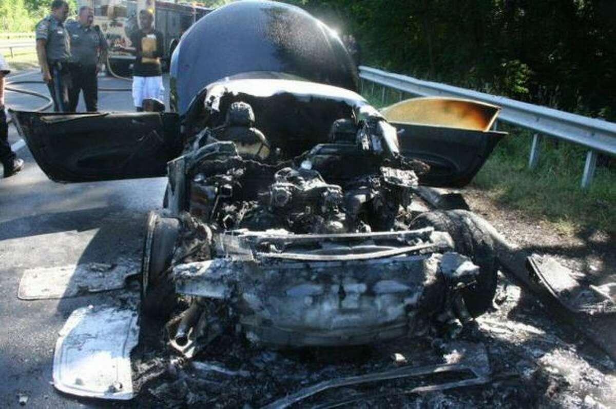 Fire officials are investigating the cause of an early morning car fire on the Merritt Parkway that destroyed an Audi R8 belonging to a Connecticut Powerball winner. (Scott R. Bisson/Contributed Photo/ Connecticut Post)