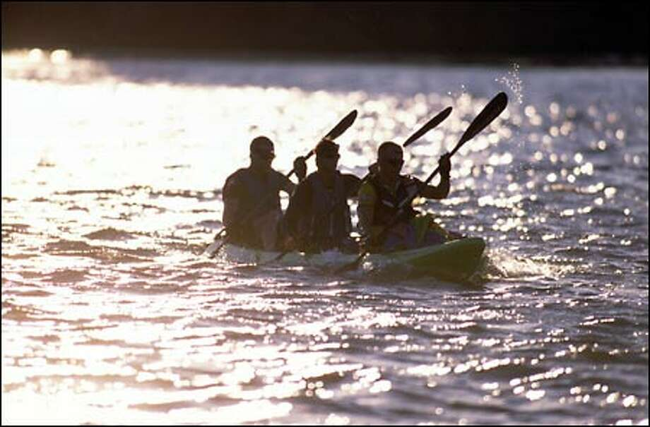 A kayak team competes in the 24-hour Adventure Race.