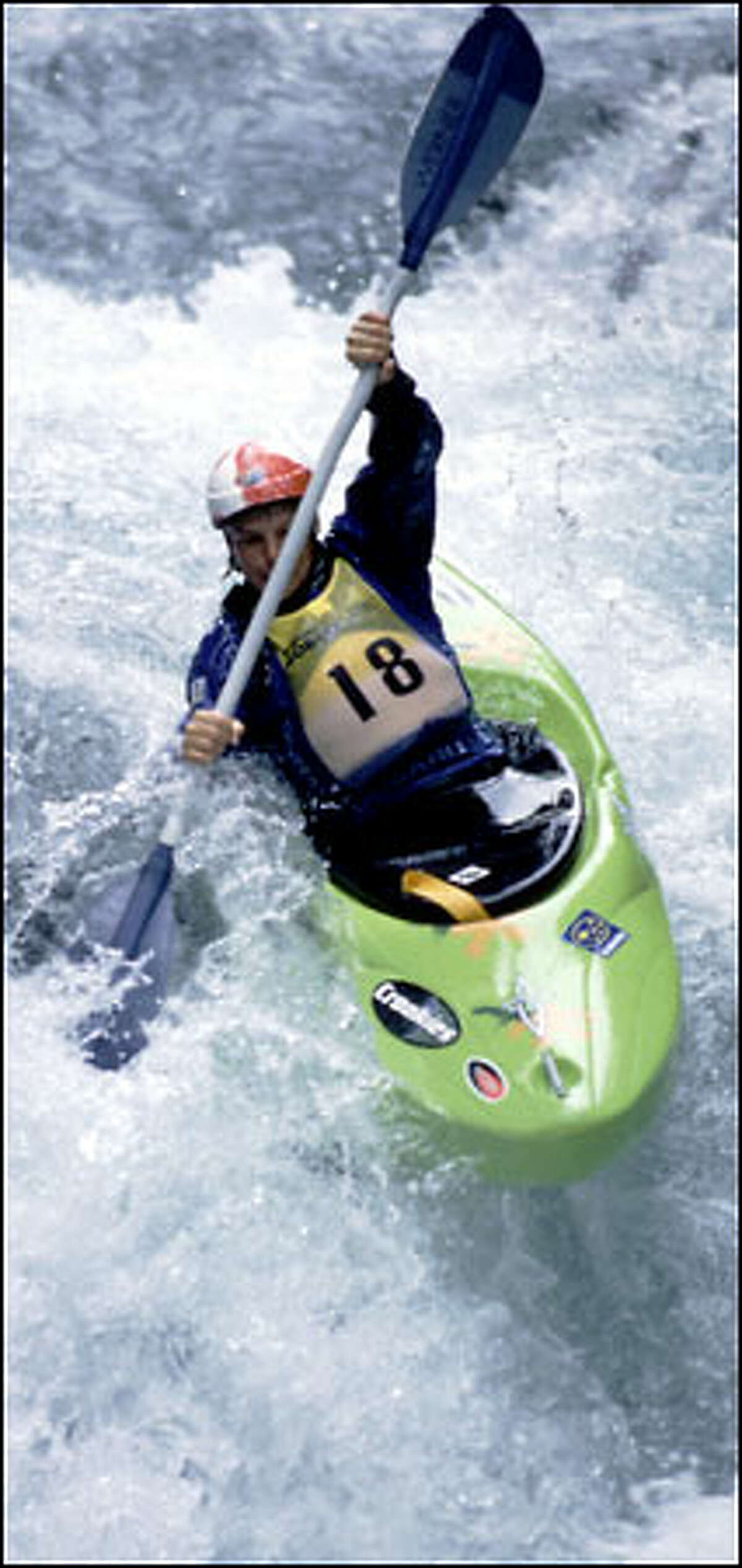 A kayaker hits the whitewater on the White Salmon River in an