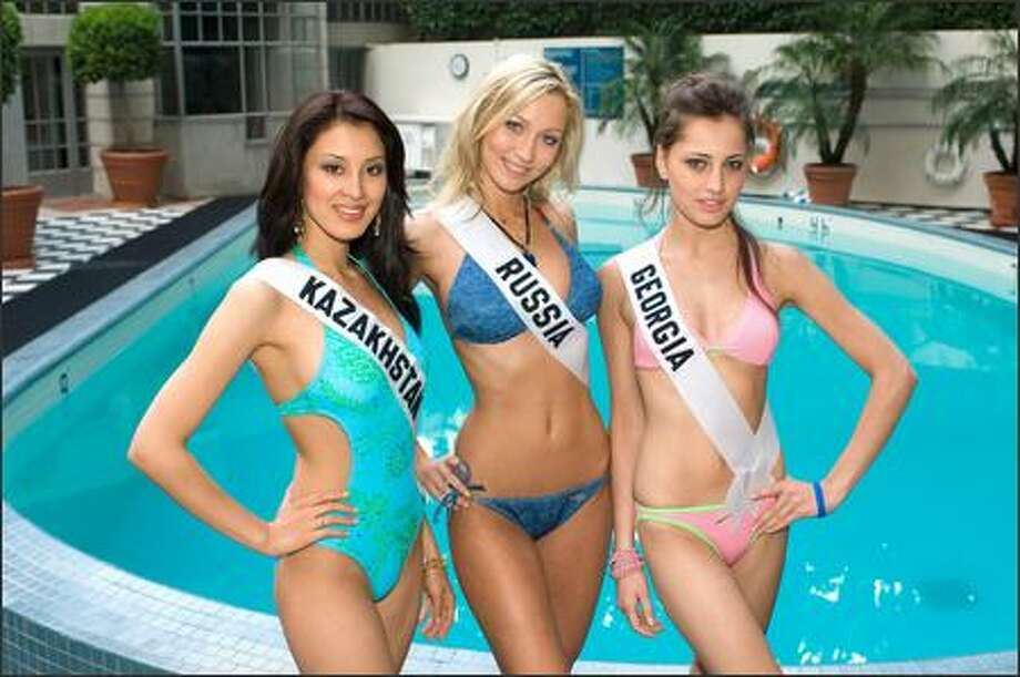 These hot babes are Miss Universe contestants posing in Los Angeles before the July 23 event. All want to work for world peace. Don't beauty contestants always say they want world peace? No. Some want to help animals. We stand corrected. Left to right, Dina Nuraliyeva, Anna Litvinova and Ekaterine Buadze. Photo: Associated Press / Associated Press