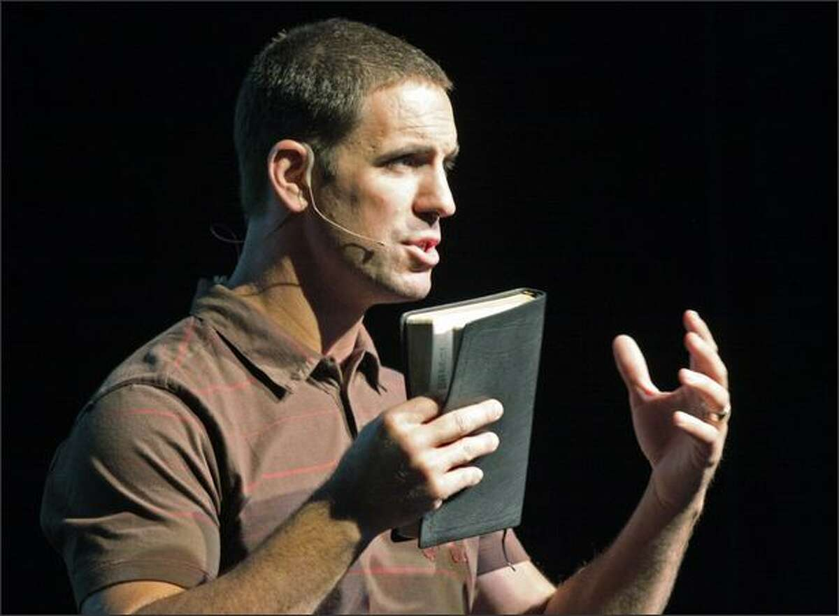Pastor Jesse Winkler leads a service at the new Mars Hill Church in Bellevue on Sunday.