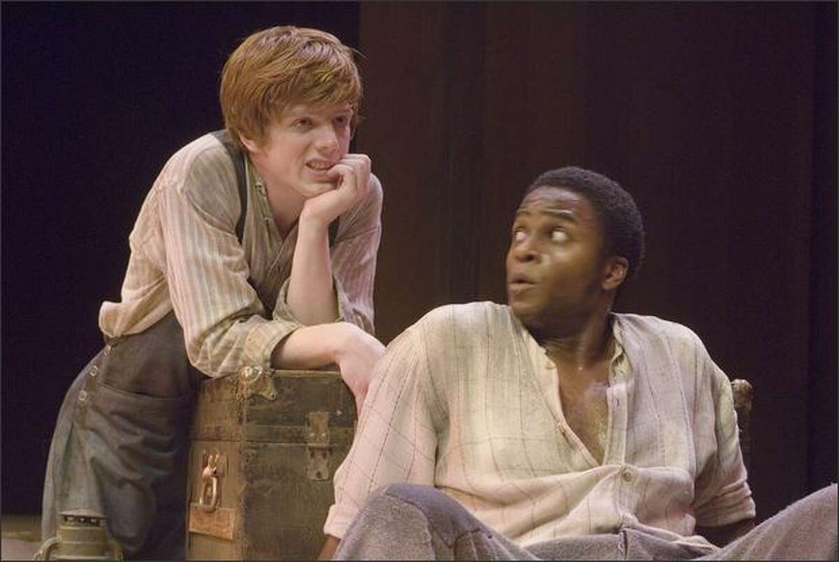 Robbie Fowler, left, cuts an impish figure as Huck, and Geoffery Simmons is a commanding presence as Jim in Taproot Theatre's