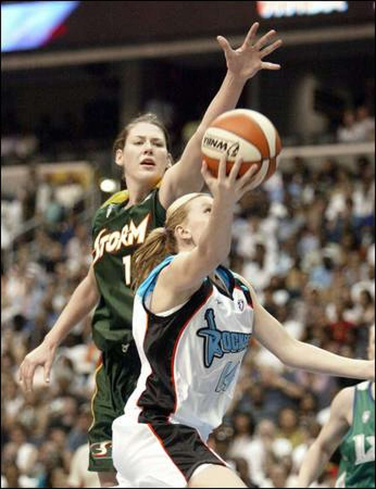 Lauren Jackson of the Storm contests a shot by Penny Taylor of the Cleveland Rockers in the second half. Rookie Sue Bird, Jackson's Seattle teammate, had seven assists, but just two points on 1-for-8 shooting.