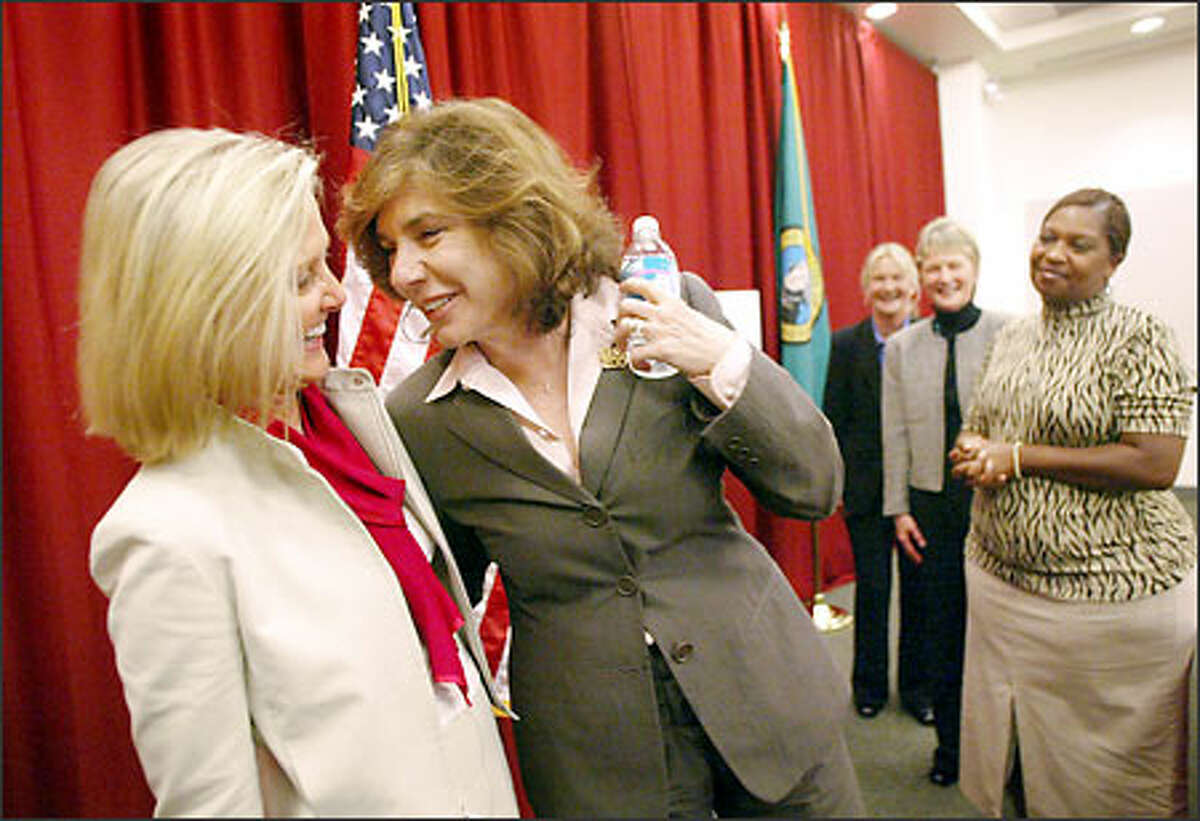 Teresa Heinz Kerry, right, meets breast cancer survivor Trish May, whose bottled-water company donates all its profits to cancer research.