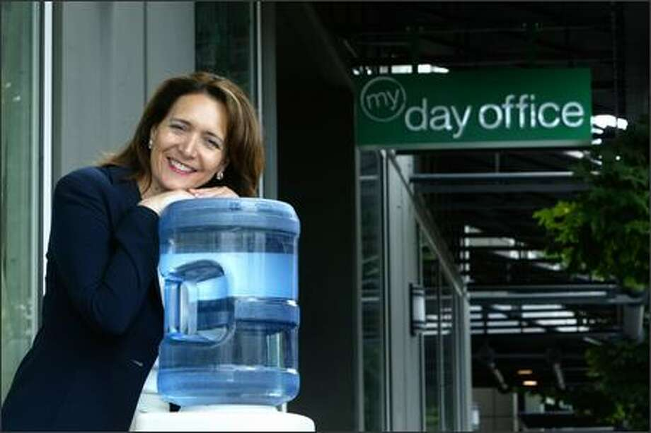 Water cooler conversation is one of the social perks Shauna Brennan hopes to provide for entrepreneurs with My Day Office, which offers temporary space and services. Photo: Andy Rogers, Seattle Post-Intelligencer / Seattle Post-Intelligencer