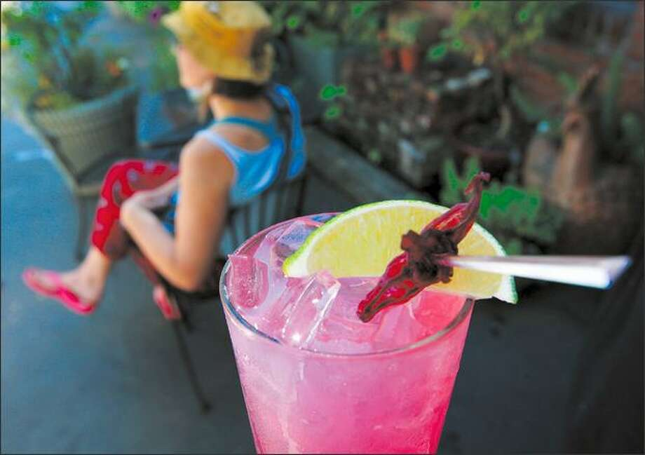 The nonalcoholic Hibiscus Lime Ginger Fizz is served at Dish D'Lish in Ballard. It is one of many nonalcoholic drinks you can make to enjoy summer's warmth. Photo: Mike Kane, Seattle Post-Intelligencer / Seattle Post-Intelligencer