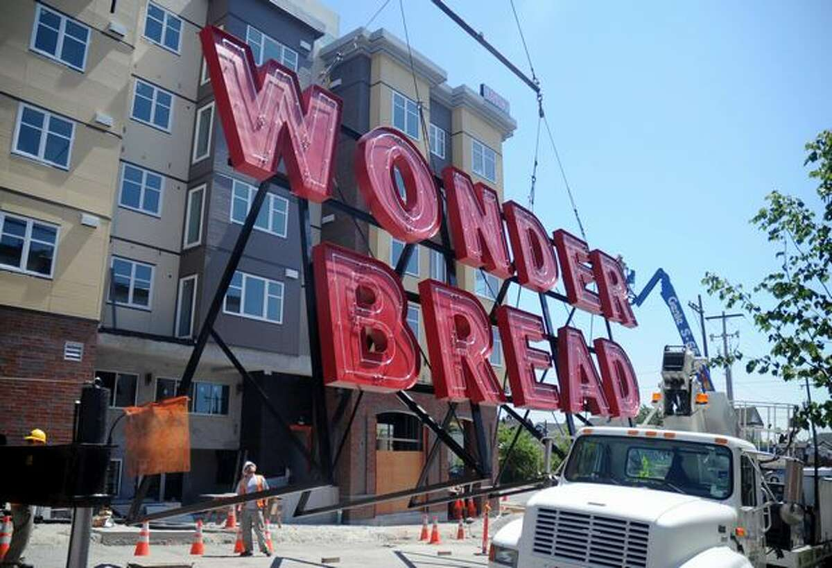 Seattle's historic Wonder Bread sign was hoisted atop a new apartment development at the former location of the Wonder Bread factory. The 7,500-pound sign, first installed in 1952, had more than 500 hours of restoration.