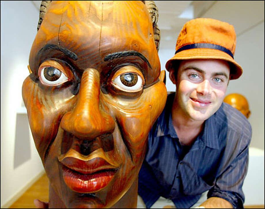 Nordfors' fascination with Africa has a huge influence on his style of sculpture. The Seattle artist's head sculptures earned him a Fulbright Fellowship to study his craft in Ghana this fall. Photo: Gilbert W. Arias, Seattle Post-Intelligencer / Seattle Post-Intelligencer