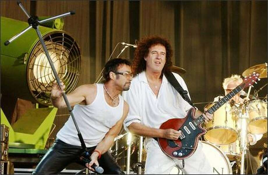 Queen's new lead singer, Paul Rodgers, and guitarist Brian May performed at a tribute show in London on Friday for the bombing victims and emergency workers. Queen last played the Hyde Park site 29 years ago, back in the Freddie Mercury days. Photo: Associated Press / Associated Press