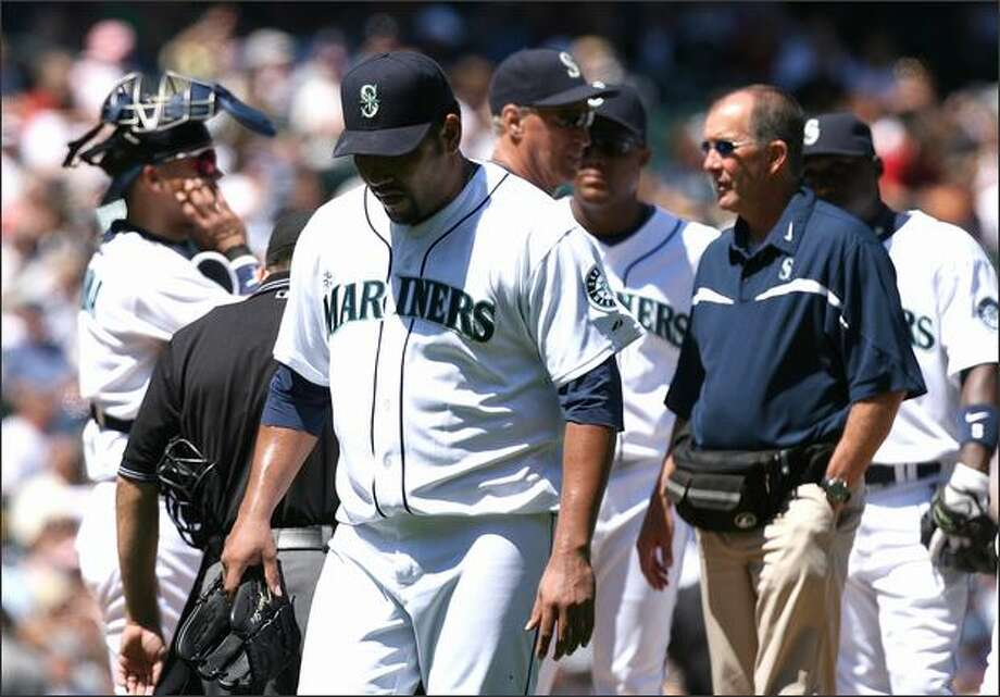Starting pitcher Carlos Silva is removed from the game with a back injury in the fourth inning of Sunday's game against the Cleveland Indians. Silva left the game with Seattle trailing 4-1. Photo: Getty Images / Getty Images