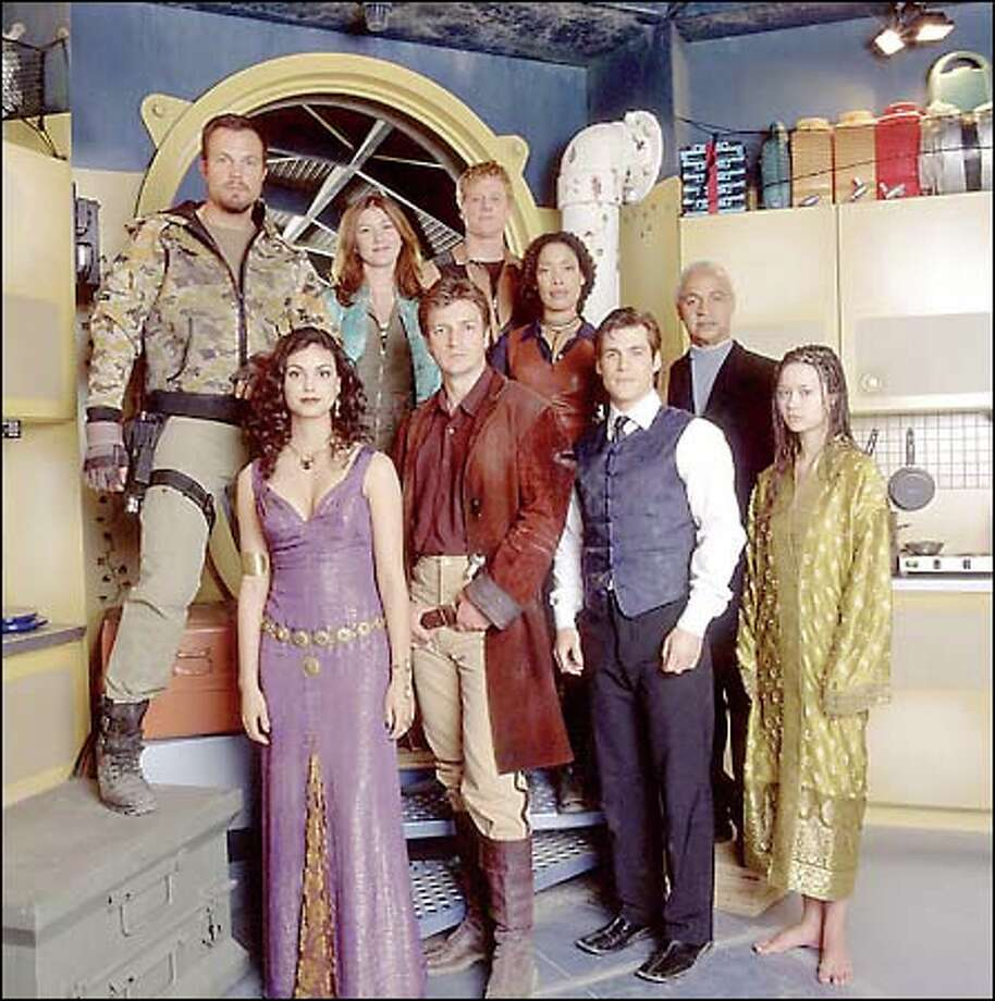 "The alien-free cast of Joss Whedon's new ""Firefly"": (clockwise from top left) Adam Baldwin as Jayne, Jewel Staite as Kaylee, Alan Tudyk as Wash, Gina Torres as Zoe, Ron Glass as Book ""The Shepherd"", Summer Glau as River tam, Sean Maher as Simon, Nathan Fillion as Captain Malcolm ""Mal"" reynolds, and Morena Baccarin as Inara. Photo: Fox / Fox"