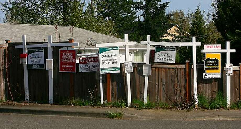 Real Estate agent signs mark the entrance to the Belgrove Townhome development in Renton on Thursday May 1, 2008. Photo Scott Eklund/Seattle Post-Intelligencer) Photo: Scott Eklund, Seattle Post-Intelligencer / Seattle Post-Intelligencer