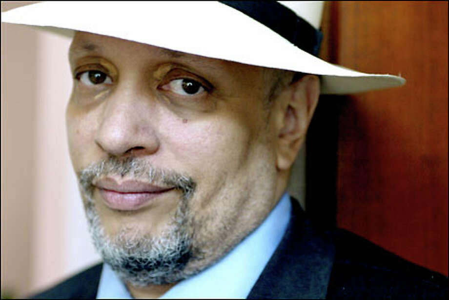 "Walter Mosley is committed to his roots. ""I'm trying to create a literature that everybody reads, but that, on the other hand, black men can enjoy,"" he says. Photo: Gilbert W. Arias, Seattle Post-Intelligencer / Seattle Post-Intelligencer"