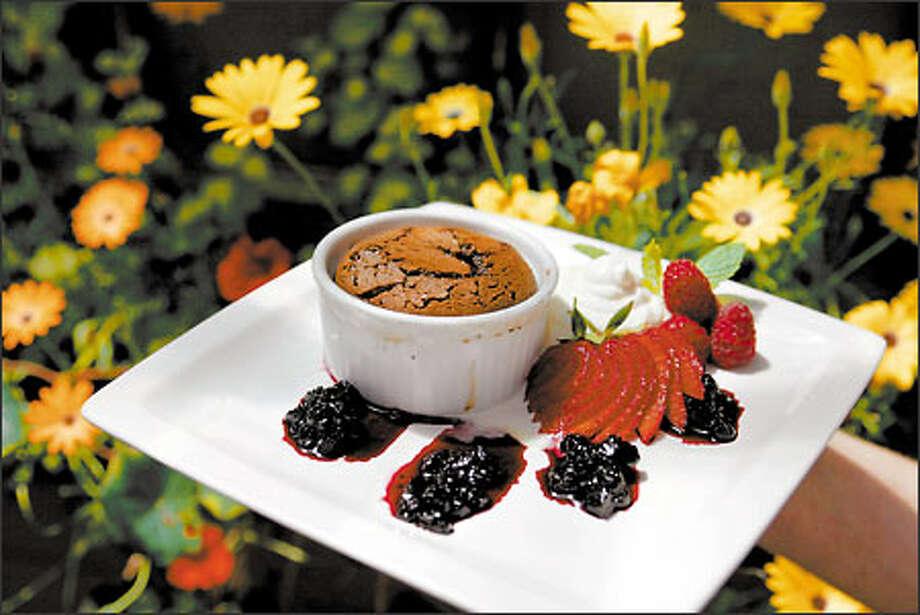 Carmelita's Warm Chocolate Muck Muck is now served in the ramekin because chef Daniel Braun says it allows it to be gooier. Photo: Scott Eklund, Seattle Post-Intelligencer / Seattle Post-Intelligencer