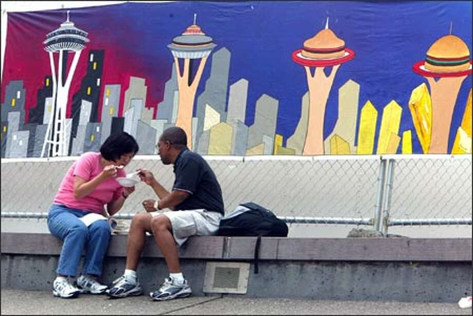 Sally Kuramoto and Colin Tudor from Seattle say they come to the Bite of Seattle every year. Photo: Karen Ducey, Seattle Post-Intelligencer / Seattle Post-Intelligencer