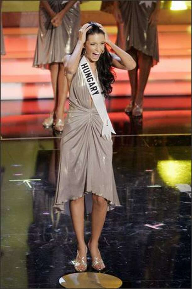 Adrienn Bende, Miss Hungary 2006, reacts after be named a finalist during the Miss Universe 2006 pageant on Sunday, July 23, 2006, in Los Angeles. (AP Photo/Mark J. Terrill) Photo: Associated Press / Associated Press