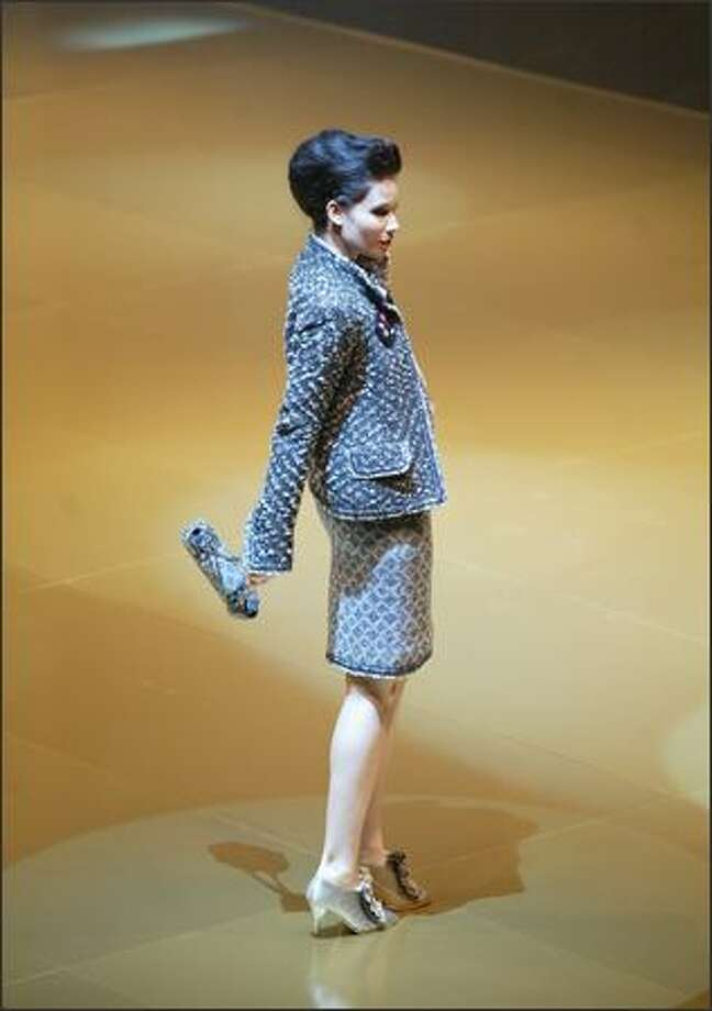 The pink and gray boucle three-piece skirtsuit by Chanel is a hot look. Photo: Scott Eklund, Seattle Post-Intelligencer / Seattle Post-Intelligencer