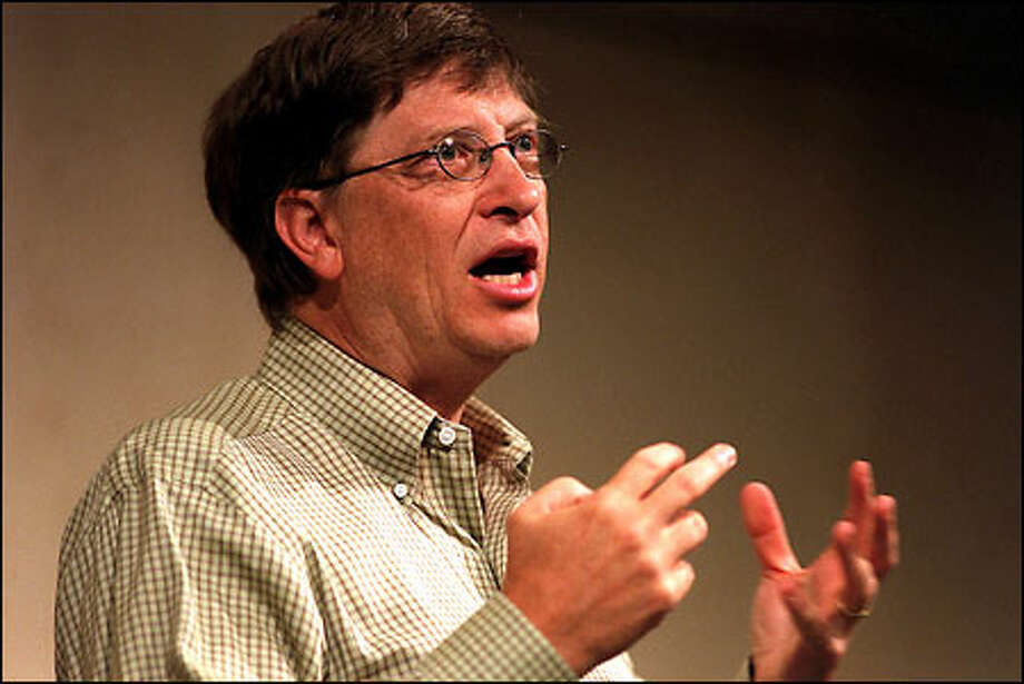 Bill Gates speaks at the Microsoft Research Faculty summit 2001 yesterday, which was attended by academics from leading institutions who came to the two-day event to exchange views and research findings. Photo: Phil H. Webber, Seattle Post-Intelligencer / Seattle Post-Intelligencer