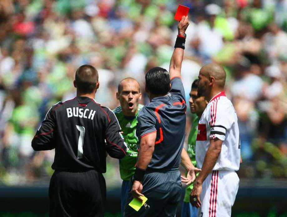 Seattle Sounders player Freddie Ljungberg reacts as referee Baldomero Toledo ejects him from the game during the second half against the Chicago Fire. Ljungberg's reaction to a yellow card led to the ejection. Photographed on Saturday July 25, 2009 at Qwest Field in Seattle. Photo: Joshua Trujillo, Seattlepi.com / seattlepi.com