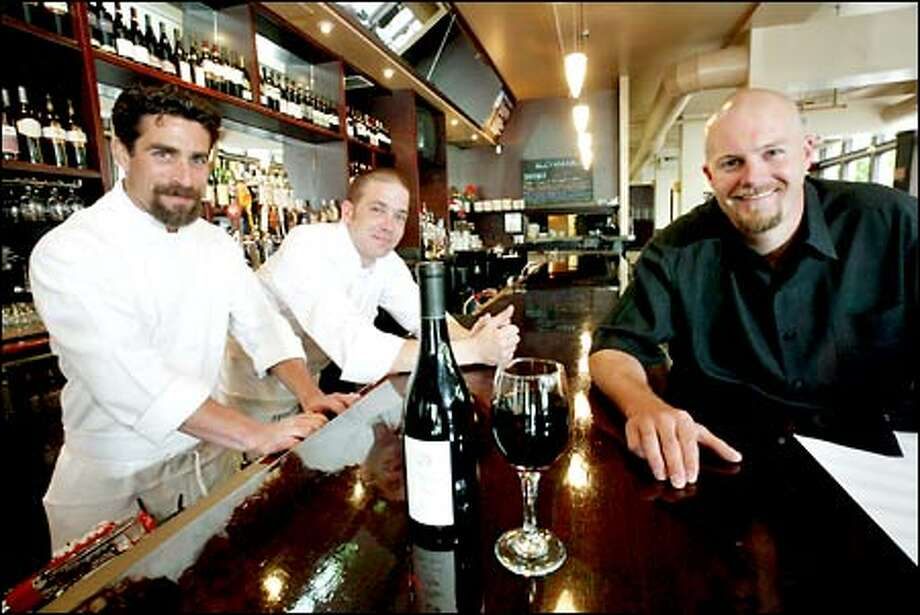 At the bar at BluWater Greenlake are Peter Levine, executive chef, left; Aaron Pratt, chef de cuisine; and Dan Anderson, owner. Photo: Dan DeLong, Seattle Post-Intelligencer / Seattle Post-Intelligencer