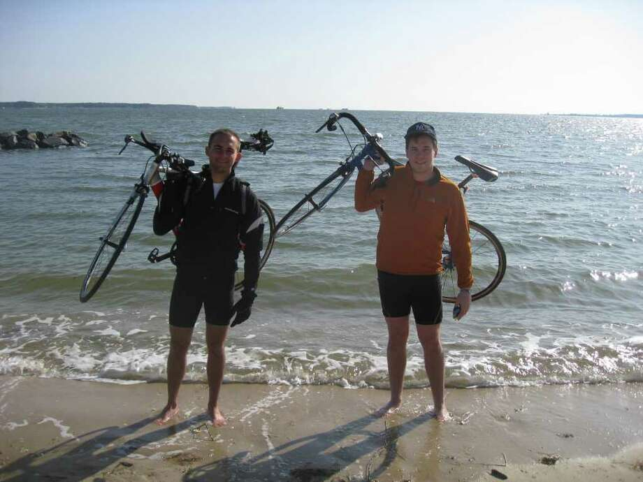 Greenwich natives Greg Riddell, 19, left, and his friend Nick Hoffmann, 20, at a Yorktown, Va., beach on March 15 at the start of their 3,760-mile trip across the U.S. to raise funds and awareness for The Wounded Warrior Project. Photo: Contributed Photo / Greenwich Time Contributed