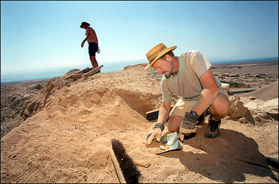 Dennis Walker, an American archaeologist from California State University, works on the remains of a mausoleum found in barren hills on Israel's West Bank. The famous Dead Sea Scrolls were discovered nearby in 1947. Photo: Associated Press / Associated Press