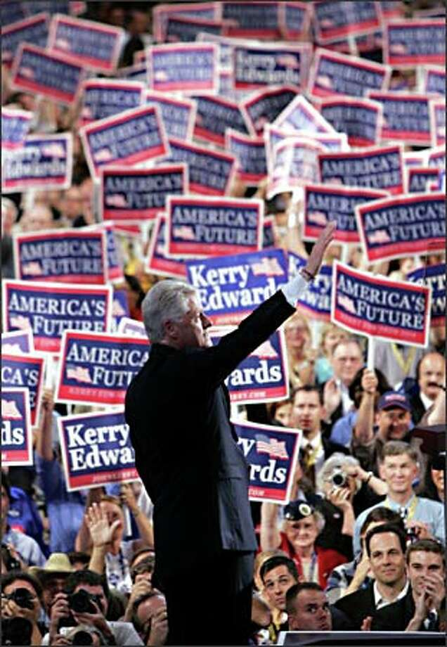 Former President Clinton's address to the delegates at the convention was punctuated by frequent cheers. Photo: Associated Press / Associated Press