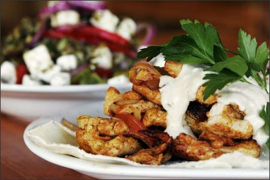 The Shawarma Plate is a snappy dish of white meat chicken marinated in spices. Israeli chef George Rashed says that, except for salt, all his spices are from the Holy Land. Photo: Meryl Schenker, Seattle Post-Intelligencer / Seattle Post-Intelligencer