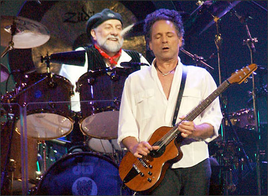 Fleetwood Mac members Mick Fleetwood, left, and Lindsey Buckingham brought out the kid in many middle-aged fans at the Saturday night show. Photo: Associated Press / Associated Press