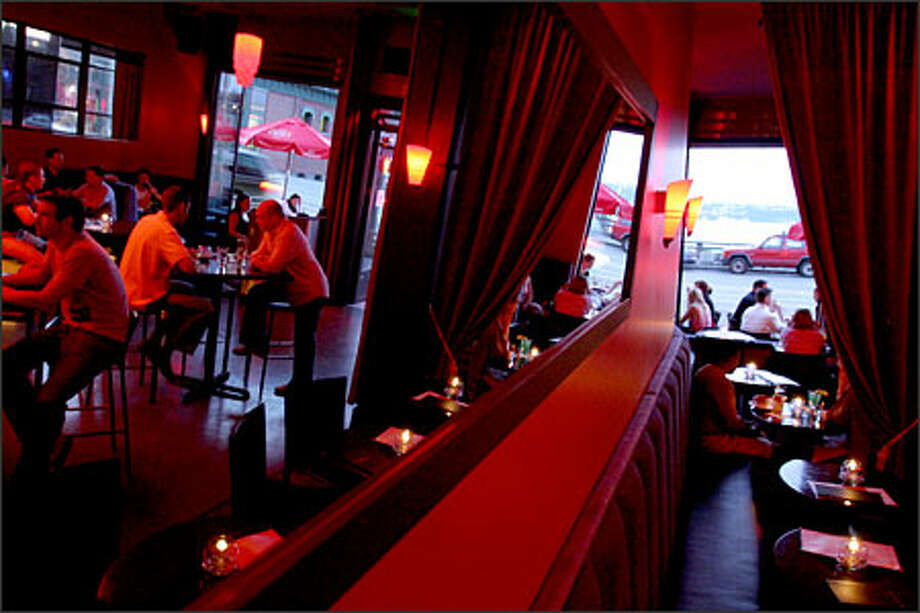 Candles, high ceilings and comfortable booths combine to give the colorful lounge The Del Rey a classic '40s vibe. The restaurant's location in Belltown also makes it the ideal spot to start an evening out. Photo: Joshua Trujillo, Seattlepi.com / seattlepi.com
