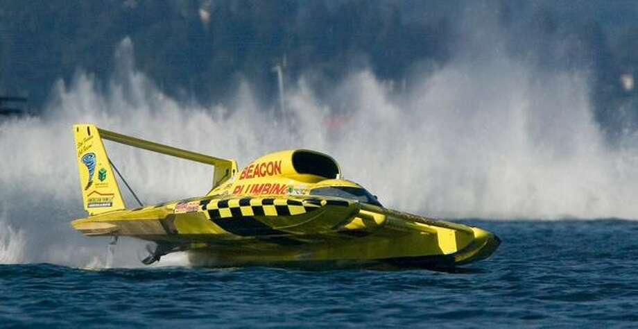 Miss Beacon Plumbing with driver Jean Theoret catches airborne during the second lap of the Finals at the Seafair Chevrolet Cupon Sunday, Aug 4, 2008, in Seattle. Theoret was penalized for driving too slow at the start. (Jim Bryant/PI Photo) Photo: Jim Bryant, Seattle Post-Intelligencer / Seattle Post-Intelligencer