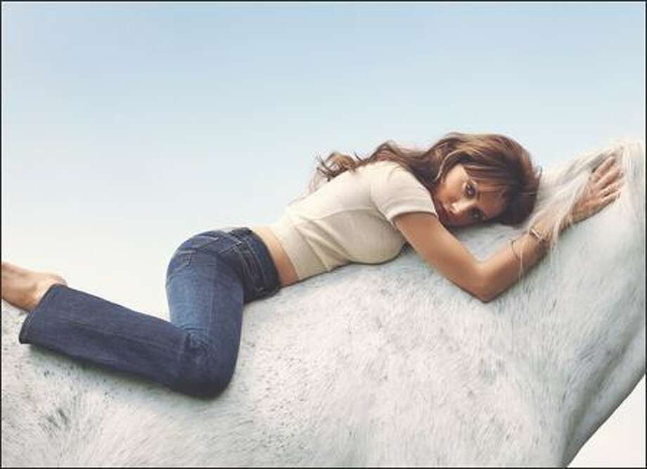 "Jordache has selected its first celebrity ""Jordache girl"" -- Brittany Murphy. She will star in a series of new ads for the company that rode the designer-jeans craze of the'70s to its greatest heights. Can you believe Murphy had never ridden a horse before this picture was taken? She seems so, uh, relaxed. Photo: Associated Press / Associated Press"