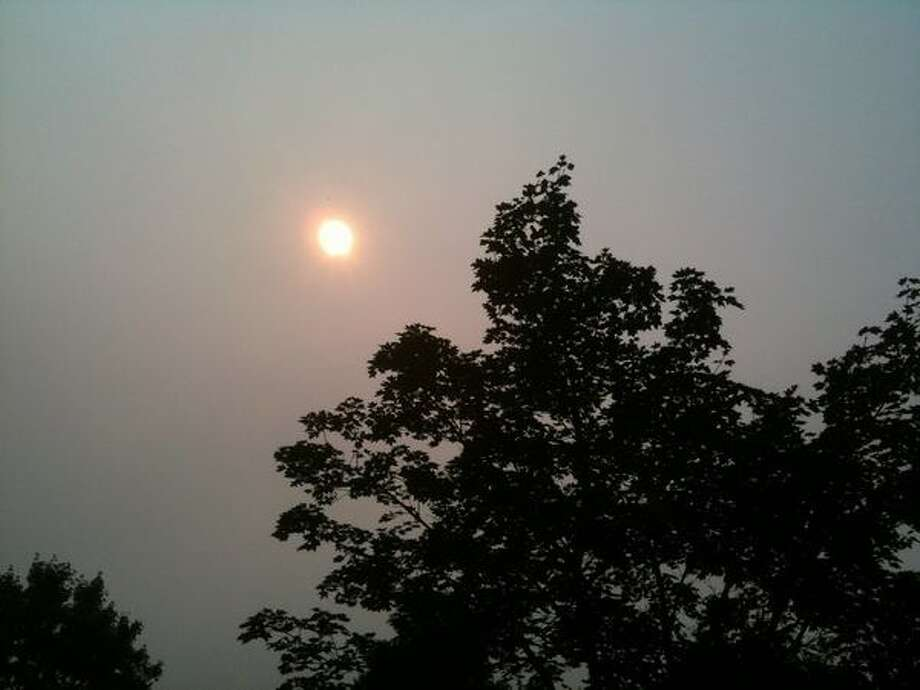 The sun burns a strange, multi-hued glow through smoky skies Sunday afternoon as seen from Poulsbo. Photo: Shannon Fears, Seattlepi.com / seattlepi.com